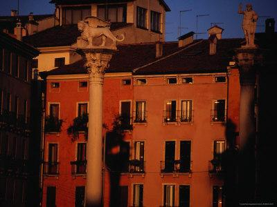 Winged Lion of Venice in Front of Terracotta Coloured Apartments, Venice, Italy