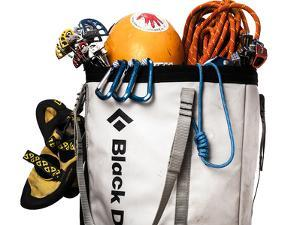 A Haul Bag Overloaded with Rock Climbing Gear by Dan Holz