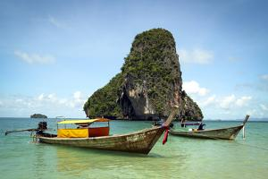 A Longtail Boat Floats Off Shore of Pranang Beach - Railay, Thailand by Dan Holz