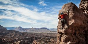 A Young Male Climber on the Third Pitch of the Classic Tower Climb, Fisher Towers, Moab, Utah by Dan Holz