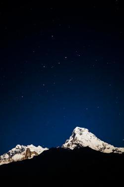 Annapurna and Annapurna South Lit by a Nearly Full Moon under a Blanket of Stars, Ghorepani, Nepal by Dan Holz