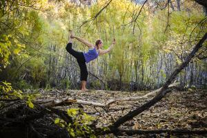 Katie Paulson Practices Yoga Among The Cottonwood Trees In An Autumn Morning In Indian Creek, Utah by Dan Holz