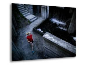 Lisa Eaton Goes for an Early Morning Run in Freeway Park - Seattle, Washington by Dan Holz