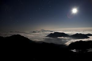 Moon Sand Stars Shine Above Low Lying Clouds on Mount Rainier National Park by Dan Holz