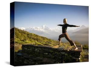 Yoga  in the Morning Sun Upon Poon Hill Along the  Anapurna Circuit - Ghorepani, Nepal by Dan Holz