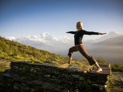 Yoga  in the Morning Sun Upon Poon Hill Along the  Anapurna Circuit - Ghorepani, Nepal