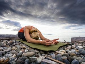 Yoga Position of Child's Pose in Lincoln Park - West Seattle, Washington by Dan Holz