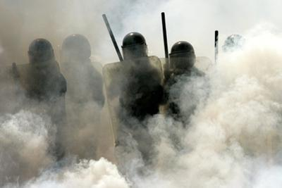Federal Police Officers Stand Amidst Tear Gas During Operation Outside Oaxaca University