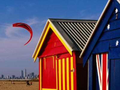 Beach Huts with Kitesurfer and City Skyline in the Background, Brighton
