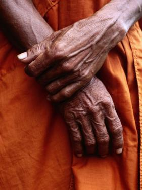 Close Up of Monk's Hands by Daniel Boag