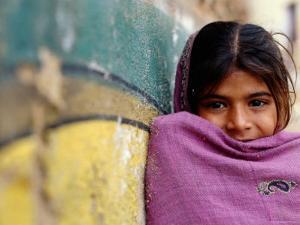Girl Leaning Against Wall, Mandawa, Rajasthan, India by Daniel Boag