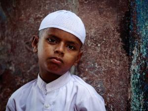 Muslim Boy in Chandni Chowk, Delhi, India by Daniel Boag