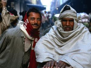Two Workers in Market Azadpur Sabzi Mandi, Azadpur, Delhi, India by Daniel Boag