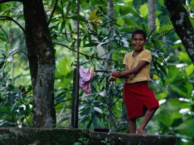 Village Girl at Water Tap, Fiji