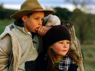 Young Farm Boy and Girl Leaning Against a Fence Post, Hamilton, Victoria, Australia by Daniel Boag