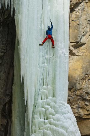A Male Ice Climber Climbing the 6th Pitch of Broken Hearts, (Wi5), Cody Wyoming
