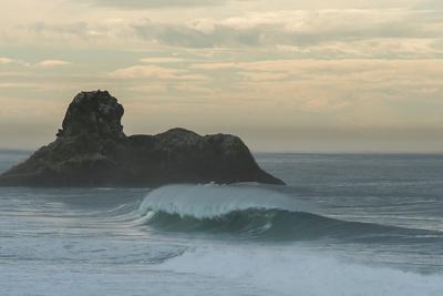 A Well Groomed Wave Breaks Unridden Somewhere Along The Big Sur Coastline