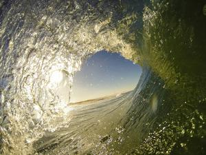 Surfers and the Waves They Ride by Daniel Kuras