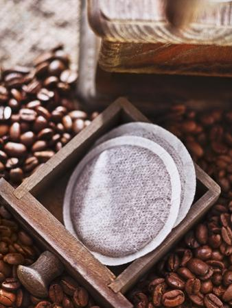 Coffee Pads, a Coffee Mill and Coffee Beans