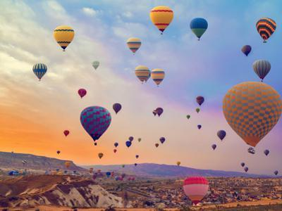Hot Air Balloons Flying over Mountains Landscape Sunset Vintage Nature Background by Danilin VladyslaV Travel