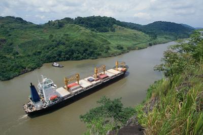 Cargo Ship and Small Boat in Culebra Cut