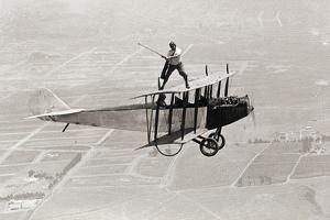 Daredevil Al Wilson Golfing on Biplane