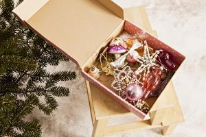 Box with Chistmas Ornaments Next to Christmas Tree, Munich, Bavaria, Germany by Dario Secen