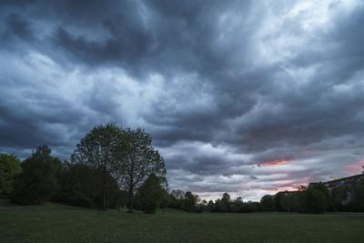 https://imgc.allpostersimages.com/img/posters/dark-clouds-above-a-park_u-L-Q1EXTBL0.jpg?artPerspective=n