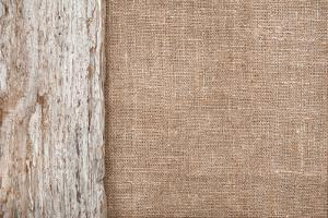 Burlap Background Bordered by Old Wood by darkbird