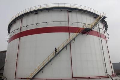 A Worker Walks Down Stairs of an Oil Tank at a Refinery in Wuhan, Hubei Province