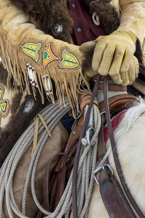 Cowboy Buffalo skin coat and beadwork detail in the Saddle, Hideout Ranch, Shell, Wyoming. by Darrell Gulin