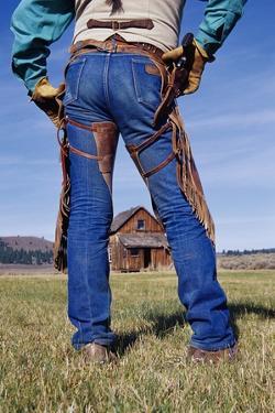 Cowboy Outside Homestead by Darrell Gulin