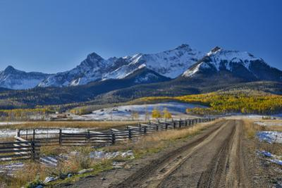 Fence Lined road and San Juan Mountain Range, Colorado by Darrell Gulin
