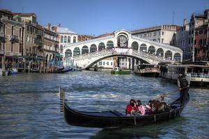Gondola Grand Canal with Rialto Bridge in Background, Venice, Italy by Darrell Gulin
