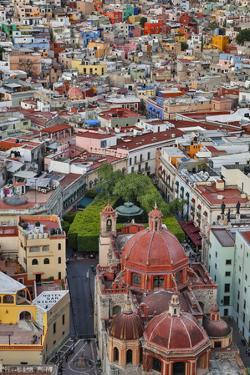 Guanajuato in Central Mexico. City overview in evening light with colorful buildings by Darrell Gulin