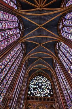 Interior view of beautiful stained glass, and arched ceiling, Sainte-Chappelle cathedral, Paris by Darrell Gulin