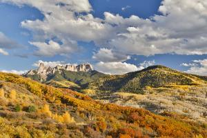 Just west of Ridgway, Colorado landscape in Autumn Castle Rock and the San Juan Mountains. by Darrell Gulin