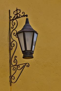 San Miguel De Allende, Mexico. Lantern and shadow on colorful buildings by Darrell Gulin