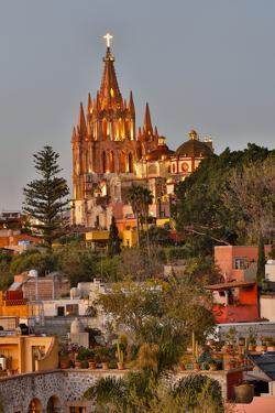San Miguel De Allende, Mexico. Ornate Parroquia de San Miguel Archangel with city overview by Darrell Gulin