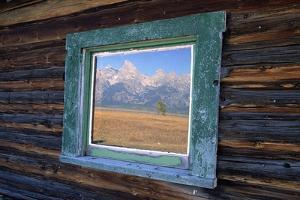 Teton Range Reflected in Window by Darrell Gulin