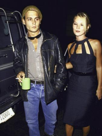 Actor Johnny Depp and Model Kate Moss at a Book Party at Danzinger Gallery by Dave Allocca
