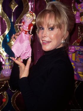 Actress Barbara Eden Holding Up Jeannie Doll by Dave Allocca