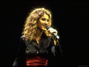 """Canadian Pop Music Star Celine Dion Singing Into Microphone During """"Hirshfeld Drawing"""" Function by Dave Allocca"""