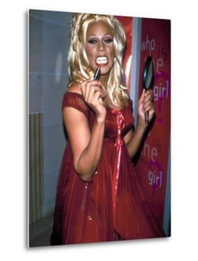 Singer Drag Queen Rupaul Wearing Red Teddy While Checking Lipstick at Event by Dave Allocca