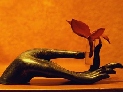 Sculpted Hand Holding Massage Oil Vial