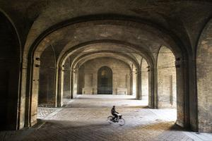 A Bicyclist Passes Through Archways in Palazzo Della Pilotta by Dave Yoder