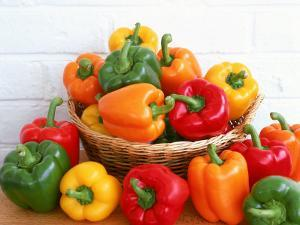Sweet Peppers in and Around Basket by David Ball