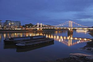 The Chelsea Bridge in London During Blue Hour, London, England by David Bank