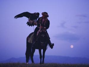 Kalanash Sarsembek with Eagle, a Hunter's Moonrise Over Steppe, Kazakhstan, Central Asia by David Beatty