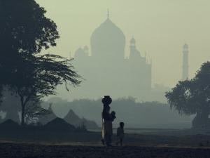 Taj Mahal with Woman and Child Silhouetted in Foreground at Dusk, Agra, Uttar Pradesh, India by David Beatty